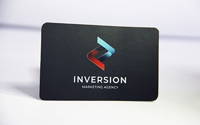 Business card with clear toner overlay